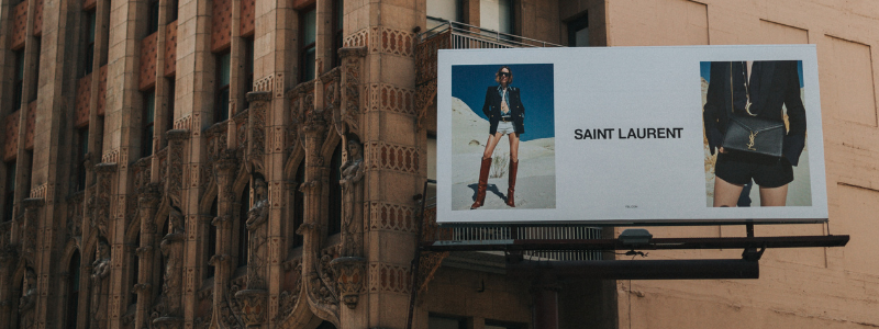 fashion billboard next to old building